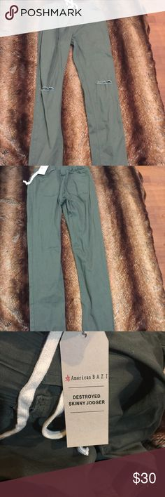 Olive ripped at the knee cadet pants Womans Size fits womans 10/11 No stretch NWT No trades Follow Www.instagram.com/stormyxstorm Snapchat:stormyxstorm Www.eastendextensions.com Pants