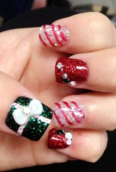 2013 Christmas candy cane nails, Christmas candy cane nails art in 2013, cupcake Christmas nails design in 2013 #Christmas #Candy #Cane #nails www.loveitsomuch.com