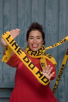 Use the bold colorways of Hometown USA to make this caution tape-inspired #knit #scarf.