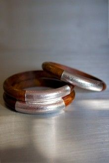 Bracelets   Handcrafted from locally sourced woods and metallic leathers by marginalized women in Northern India.