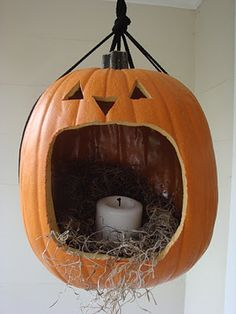 Hanging Jack O'Lantern for your front entry! Use foam pumpkin and electric candle.