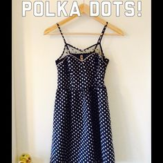 HPPolka dot hi-lo dress with mesh neckline Super cute sleeveless polka dot dress with mesh, polka dotted neckline. Straps are adjustable. No zipper, but the back panel stretches to fit. The bottom front is shorter and slopes down to a few inches longer in the back. HP 1/17/16 Best in Dresses & Skirts  Xhilaration Dresses High Low
