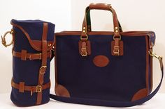 Navy blue and warm brown leather luggage. Inspire your travel with stylish bags.
