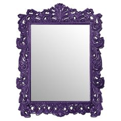 Complement Baroque-inspired decor or contrast modern furniture with this ornately carved mirror, showcasing an elaborately scrolled frame and a royal purple ...