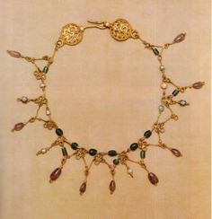 Byzantine Luxury Goods article.  This is listed as gold with pearls, green glass(!) and amethyst stones.