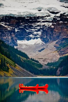 Red canoes on Lake Louise, Alberta, Canada