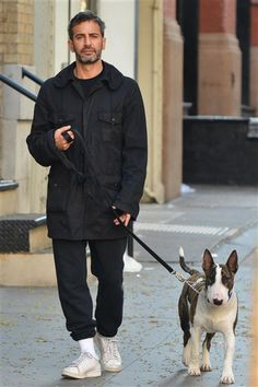 Bull terrier Neville is just as handsome and fit as his dad, designer Marc Jacobs. The father-pup duo even share the same long, lean faces -- and slightly judgmental expressions!RELATED: Fashion don'ts