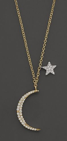 Dainty diamond-encrusted moon and star charm necklace from Meira T