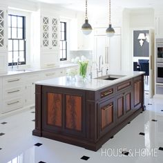 Traditional Kitchen Design By Jessica Cotton | Love the mix of rich brown wood with white modern cabinets