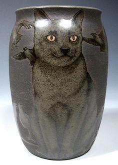 Wonderful vase embellished with charming cat.
