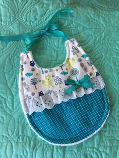 Perfect for a baby shower, this darling woodland-themed bib is fleece lined and backed in white terrycloth. Trimmed with eyelet lace and satin ribbons, it measures 9 long by 8 wide. Baby Sewing Projects, Sewing For Kids, Baby Gifts To Make, Baby Crafts, Baby Accessories, Burp Cloths, Baby Patterns, Baby Bibs, Baby Quilts