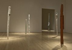 """At the National Gallery: Louise Bourgeois' """"Personnages,"""" a series of primitivist figures made in the '40s and '50s after the artist left her home in Paris for New York. Through the doorway is a work from her 2007 series """"Echoes."""""""