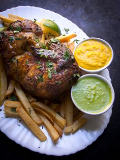 Pollo a la brasa is an easy Peruvian chicken recipe with incredible hot sauces aji verde and aji amarillo.