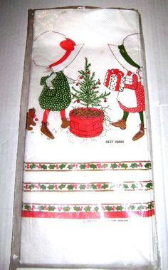 VINTAGE Holly Hobbie Christmas Table Cover from JunqueGypsy.Etsy.com in unopened plastic package w/original price tag of 1.50    White background