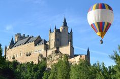 """Hot-Air Balloon Flight over Segovia or Toledo with Optional Transport from Madrid """"Flying with friends"""" Flying in a hot air balloon is an amazing experience that you will remember forever. Ballooning is both a serene and thrilling activity, offering breathtaking views and a feeling of freedom that is unique. Wonder at the beautiful Alcazarof Toledoor Segovia Aqueduct from the sky and discover the area's landscape and wildlife hundreds or even thousands of feet below.Your bal..."""