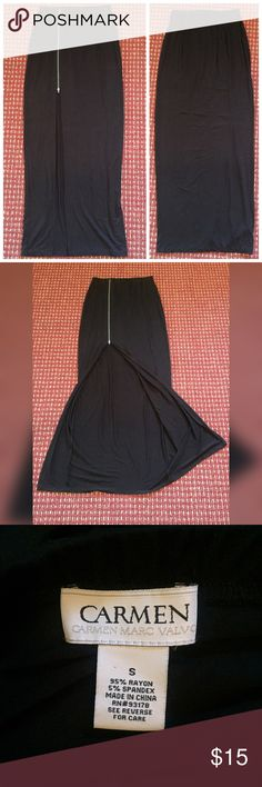 """🖤 Black Maxi Skirt 🖤 Carmen Marc Valvo brand. Size small. 95% rayon 5% spandex. Black. Maxi skirt. Zipper is functional and silver in color. ✨Super cute and like-new! Worn ONCE.✨ Measurements👉🏽 Length: 42.5"""". Length of zipper: 15"""". Length of slit (where zipper ends) 26"""". Waist: 26"""" but very stretchy! Would fit multiple sizes. BUNDLE TO SAVE! 💵💰💵💰 Carmen Marc Valvo Skirts Maxi"""