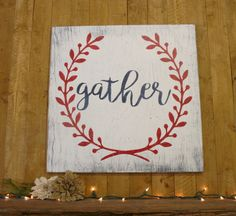 Gather! This is a wood sign that measures 20 x 20. The background shown here is White. Laurel wreath design is Flamenco Red. Word gather is