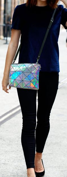 ***Metallic Holographic silver/multi colour Leather - Stunning*** Handmade in Australia   * This bag is handmade from Italian Holographic leather. Colour reflection variations occur whether you are in shade or light. Beautiful leather. * Fully lined in woven kimono fabric (see photo for options)  * 2 inside pockets (including expandable mobile pocket)  * Remove strap to use as clutch  * High quality and strong riveted black adjustable and removable strap * Easy ykk bag zip closure  * Sil...
