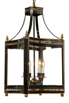 Square Pierced Design Four Light Lantern  Tole and divided glass curved square pierced design drop four light lantern. Shown in black with gold accents finish.