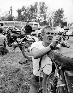 Photo (François Gragnon) – At the end of the day Steve had to od all his own mechanical work which today remains part of the ethos if the ISDT / ISDE for riders to look after themselves, in the background are two Greeves, #127 RT Snelling of Holland who dropped out on day 3 and #137 Tristan Sharp of Britain who picked up a gold medal ISDT 1964