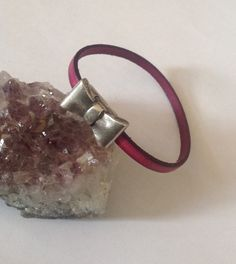 Pink leather bracelet with bow clasp by BeadyAyeJewellery on Etsy