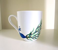 Peacock Coffee Cup- Hand Painted Porcelain Mug. $30.00, via Etsy.