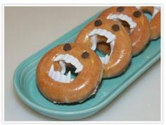 Halloween Doughnut idea using plastic vampire teeth - Anyone thinking Sleepover after a Vampire Movie Marathon? lol