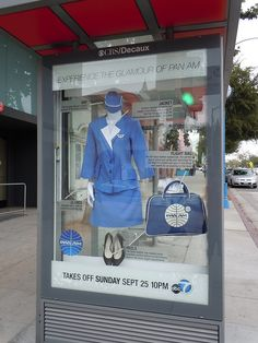 Pomotional display at a bus shelter for the new Pan Am TV show. I hope that's unbreakable glass.