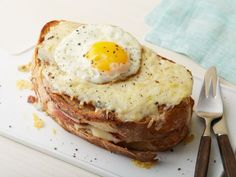 Croque Madam Sandwich: Alex Guarnaschelli prepares this French ham-and-cheese sandwich the traditional way, with a rich Gruyère and bechamel sauce. After broiling the sandwiches, she tops each with a fried egg.