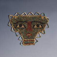 An Egyptian re-strung beaded mummy mask, comprised mostly of dark green faience beads, surrounded by a yellow faience bead border. Mummy Museum, Egypt Culture, Egyptian Mummies, Antiquities, Ancient Art, Bead Art, Oriental, Beads