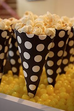 Serving popcorn....make out of scrapbook paper...notice COLORED JELLY BEANS for standing the cones! Cute idea!
