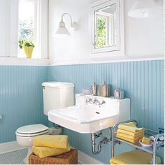 Small Space Decorating Tips: Teeny Tiny Bathrooms  {This is similar to the color that my {ex} bonus daughter picked out for the upstairs bathroom. I've been waxing and waning if I like it. It looks pretty good here. I think I like the yellow accents.}