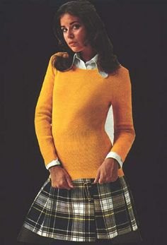 plaid kilt with huge safety pin and crew neck sweater - I have pictures of me in this outfit.