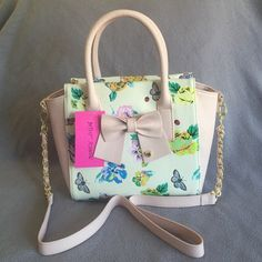 Betsey Bag Beautiful, medium size satchel, available Crossbody straps, pink bow, floral/butterfly print, gold hardware. Betsey Johnson Bags Satchels