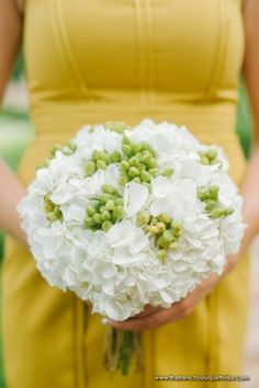 This beautiful bouquet is a perfect example of white with a pop of color. White Hydrangea and green Hypericum are available at GrowersBox.com.