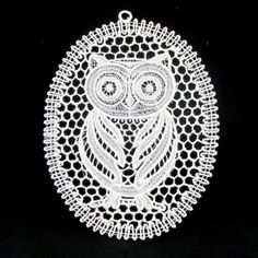 This is a free standing lace Owl Suncatcher. It would look beautiful hanging in a window, on a Christmas tree or even in a scrapbook.  It is