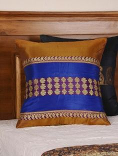 Brown - Blue Handwoven Baluchari Paisley Floral Cushion Cover 16in X 16in This exquisite silk cushion cover is a handwoven Baluchari textile from Bengal with elaborate depictions of mythological scenes, specially the Ramayana and Mahabharata. The front has a rich silken texture while the back is in soft cotton fabric, making these perfect to dress up corners of your home.