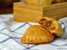 Cuuking! Recetas de cocina: Empanadillas de atun con tomate al horno.