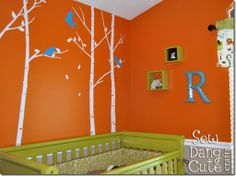 love the trees from the chair rail up. And the Green crib!