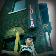Serendipity...my daughter Lola under her trendy namesake Denver LoHi restaurant Lola