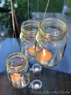 Light Up the Night: A Mason Jar Project - A Pretty Life In The Suburbs. Lanterns made from mason jars. Mason Jar Lanterns, Hanging Mason Jars, Mason Jar Lighting, Mason Jar Chandelier, Mason Jar Projects, Mason Jar Crafts, Mason Jar Diy, Diy Jars, Outdoor Hanging Lanterns
