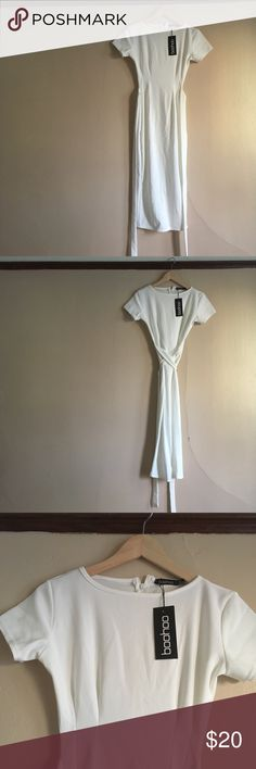 """NWT Boohoo white pencil dress Midi length (I'm 5'5"""" and it hits right below my knee), stretch pencil dress. Body con. Crisscrossing ties around the waist. Hidden zipper down the back. Only worn to try on. Size four, fits true to size.   Second photo is for style reference- same dress just in a different color. Boohoo Dresses"""