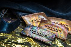 Hot printed iridescent leather labels made in Italy by Panama Trimmings Leather Label, Metal Texture, Hang Tags, Iridescent, Patches, Brand New, Emboss, Panama, Fabric
