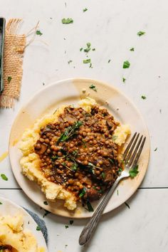 A hearty serving of fiber- and protein-packed Lentil Mushroom Stew Over Mashed Potatoes