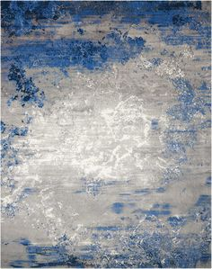 $2,624.30    Like floating clouds in a windswept sky, the soft grey hues in this lovely area rug seem to swirl in changing formations, backlit by touches of luminous white on the field of rich Twilight blues. An evocative, chic and contemporary look for...