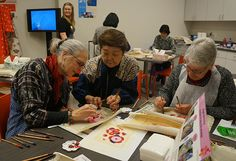 Bingata stencil workshop in the museum's educational center with participants (l-r): Susan McCauley, instructor Sachiko Yafuso and Diane Wolman. Photo by Candace Edgerley