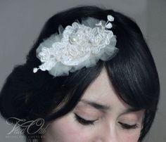 Mecia- Bridal Alencon lace hair comb available in several colors. $46.00, via Etsy.