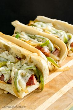 Kielbasa Hoagie Sandwiches with Sausage and Peppers - This is some perfect tailgating food! Man Food! Easily grilled or sauteed on a stove if you doing some homegating.