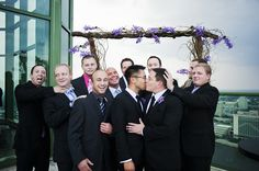 """After saying """"I do,"""" the grooms sealed the deal with a kiss as their friends and family celebrate. #bestkiss #gay #wedding"""