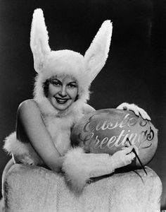 Woman in Bunny Costume with Easter Egg